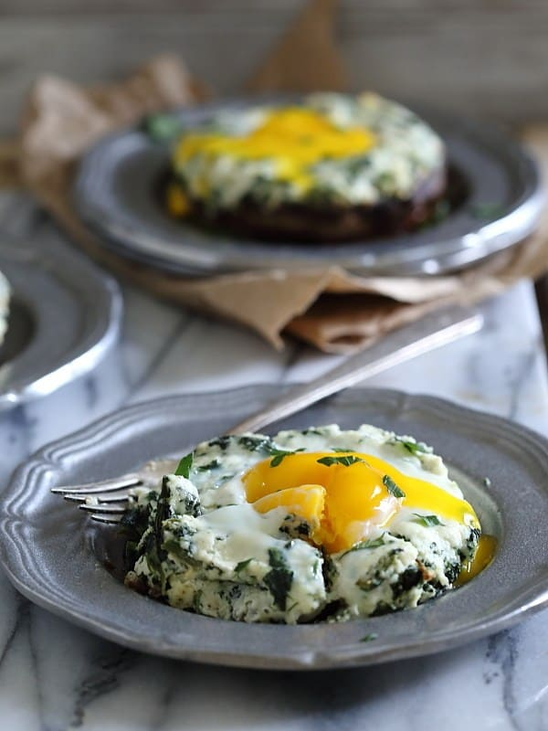 These portobello mushrooms are stuffed with a ricotta spinach mixture and finished with a runny egg that's baked right on top. They're a perfect quick dinner or savory breakfast.
