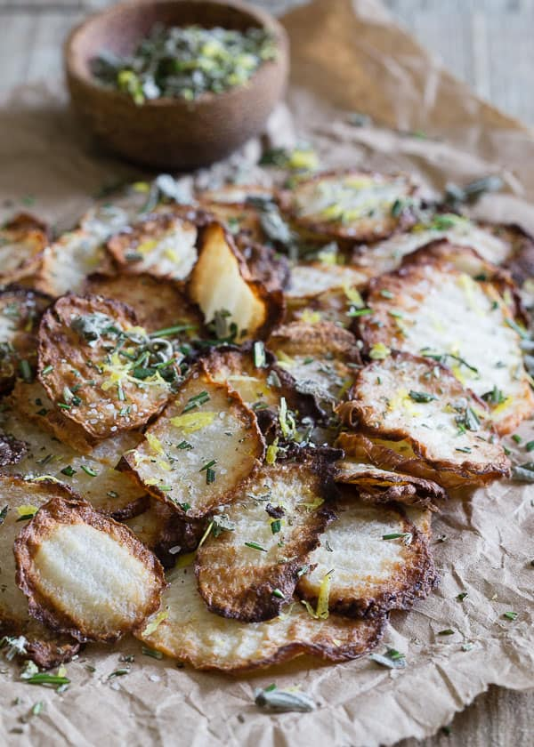 These easy pan-fried jicama chips are tossed with fresh herbs and citrus zest for a deliciously crunchy alternative to potatoes.