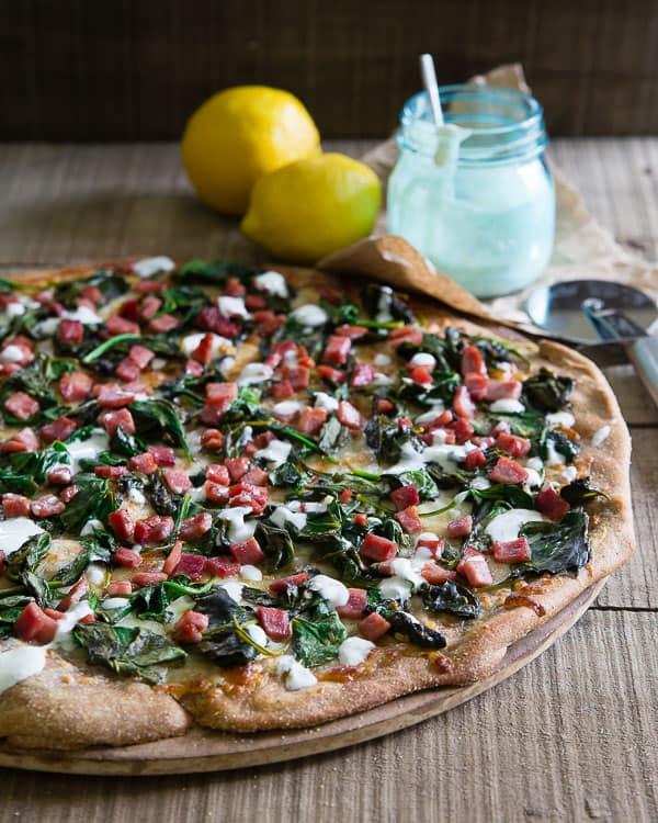 Warm spinach and crispy ham pizza