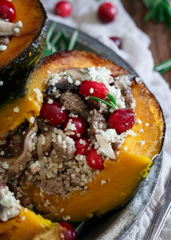 Stuffed kabocha squash with wild mushrooms, cranberries, lamb and blue cheese