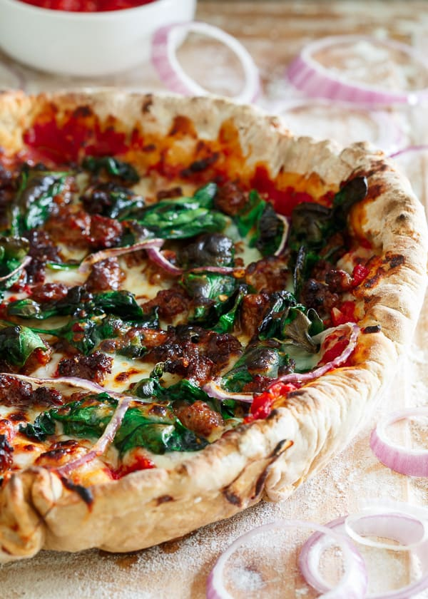 Somewhere between deep dish and regular pizza, this whole wheat chorizo spinach skillet pizza starts off with a quick homemade tomato sauce and is topped with plenty of fresh cheese, spicy chorizo, spinach and onions.
