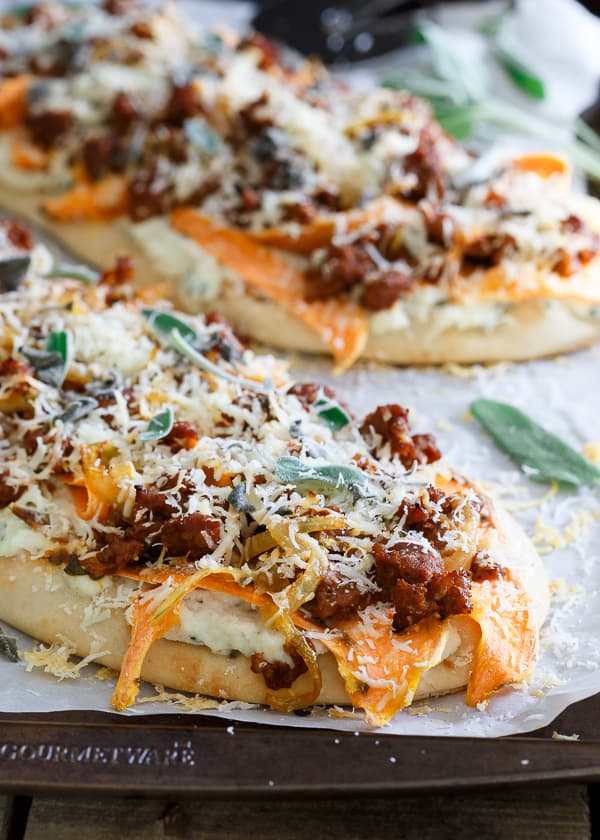 There's so much savory goodness in every bite of this sage chorizo sweet potato naan pizza. With a creamy ricotta base and a sharp parmesan topping, it's pizza heaven!