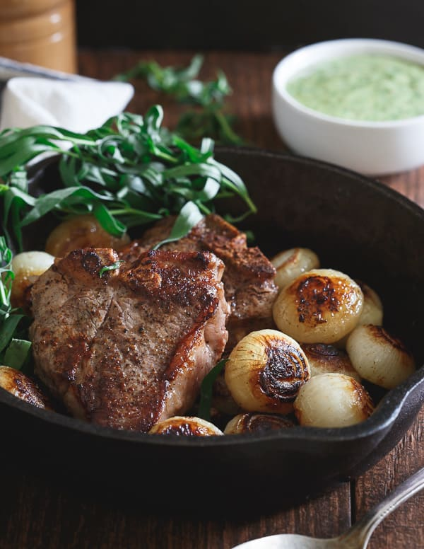 These American skillet lamb chops are made stove top in the skillet with browned cipollini onions. Topped with a fresh tarragon honey mustard sauce, they're a bright, refreshing and incredibly quick dinner!