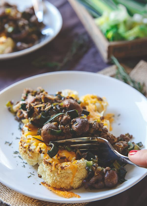 Bison and Cheddar Topped Cauliflower Steaks make a hearty and comforting winter meal packed with flavor.