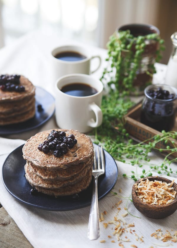 These cinnamon raisin oat bran pancakes have a combination of oat bran and buckwheat for a hearty texture with a touch of nutty toasted coconut.