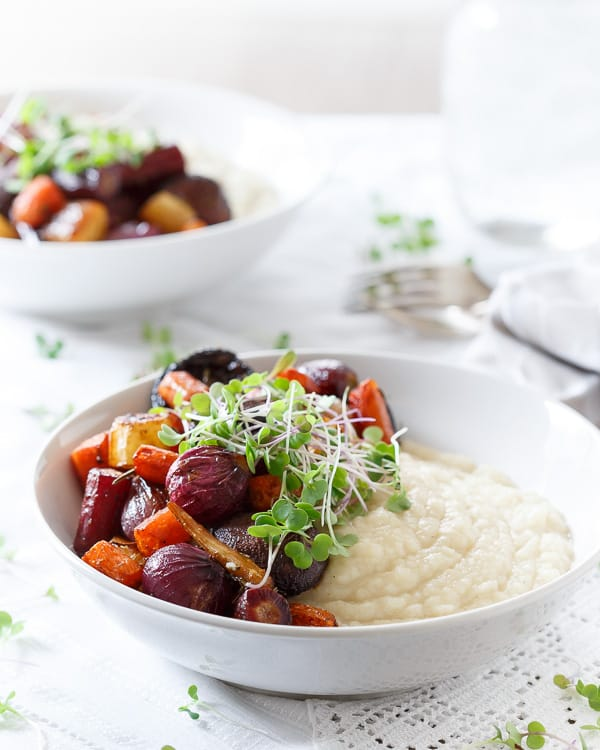 Sweet balsamic coated rainbow carrots, pearl onions and mushrooms are roasted until tender and served on top of a creamy celery root puree.