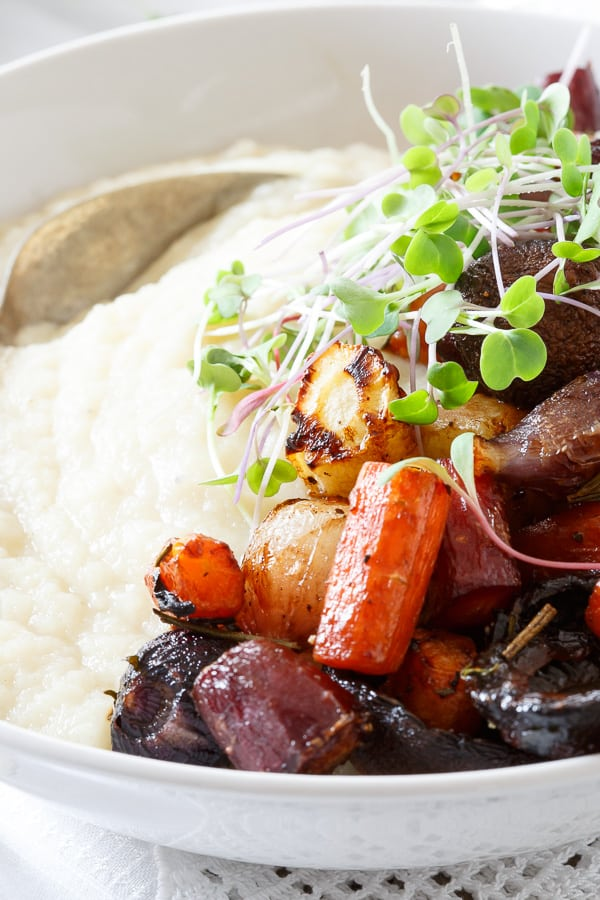 Roasted balsamic carrots, mushrooms and onions are served on top of a creamy celery root puree.