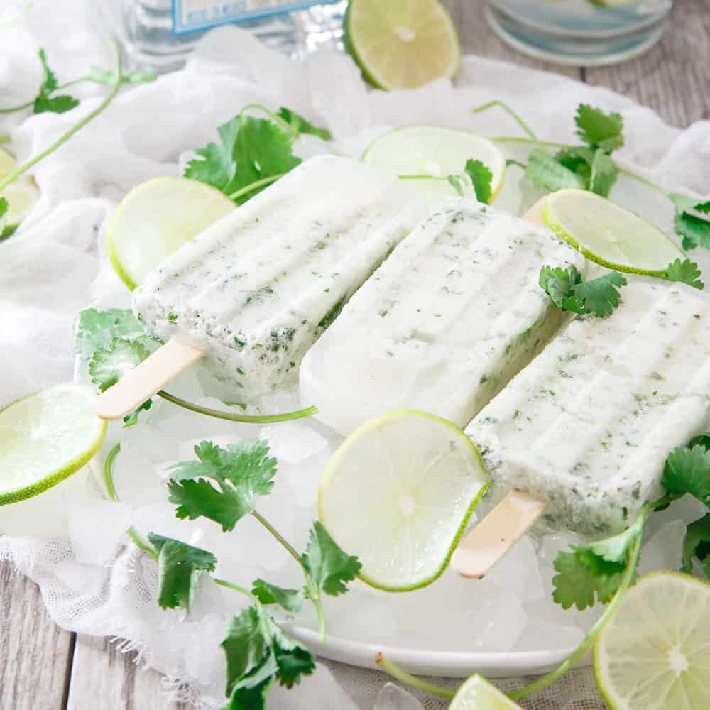 These coconut cilantro margarita ice pops are a refreshing and boozy bite. What better way to do happy hour than with a margarita ice pop?