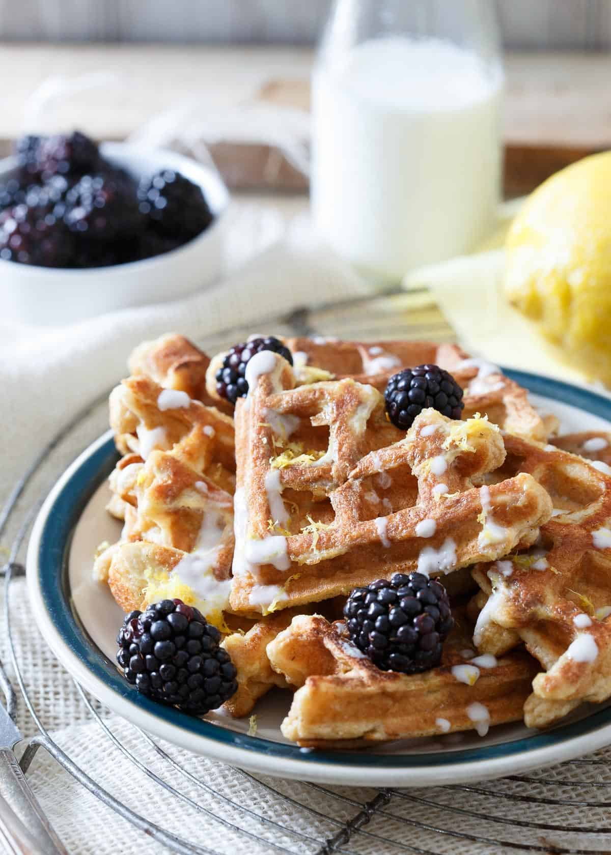 This lemon vanilla waffle French toast takes two of your favorite breakfast foods and combines them into one delicious way to start the day!