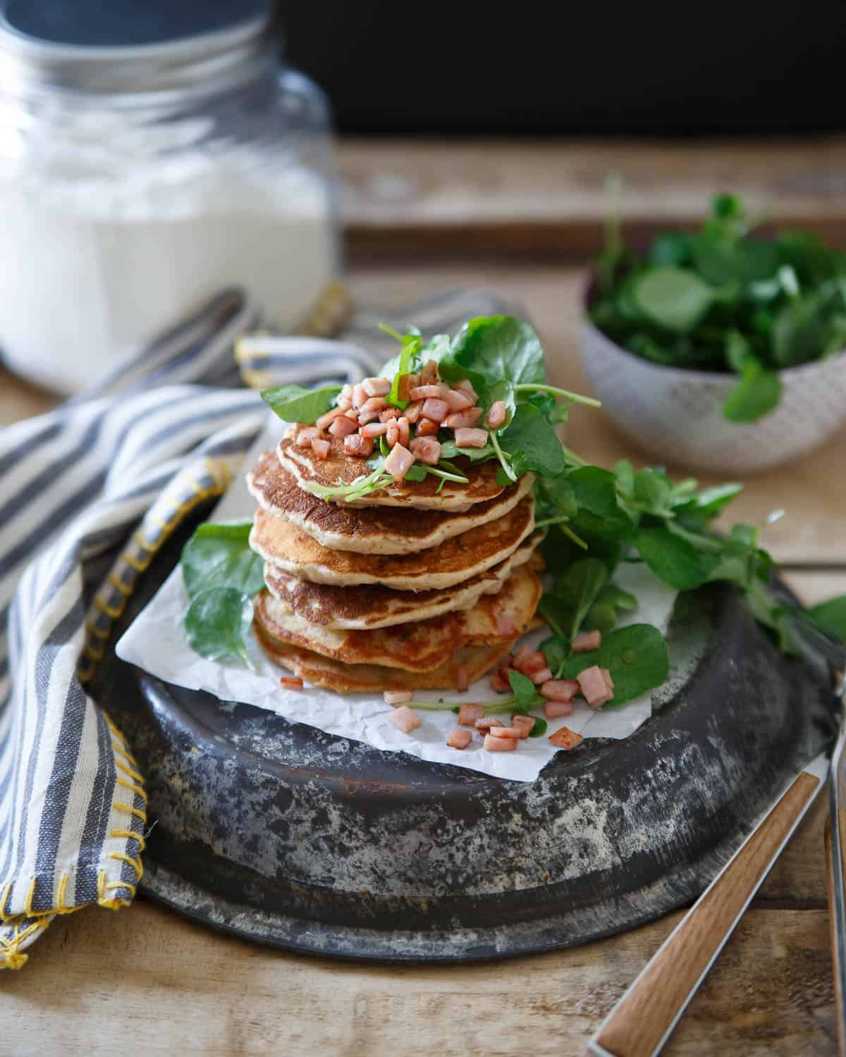 These Canadian bacon pancakes are stuffed full of savory shallots, herbs and Canadian bacon then topped with a crisp watercress salad. Perfect for brinner!