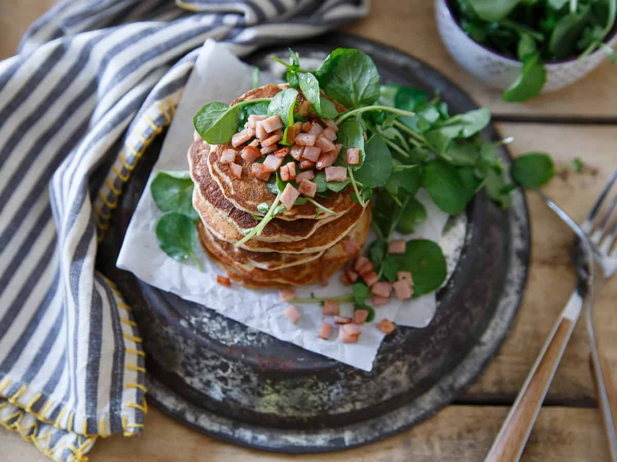 Savory Canadian Bacon Pancakes filled with shallots and herbs, topped with a crispy and refreshing watercress salad.