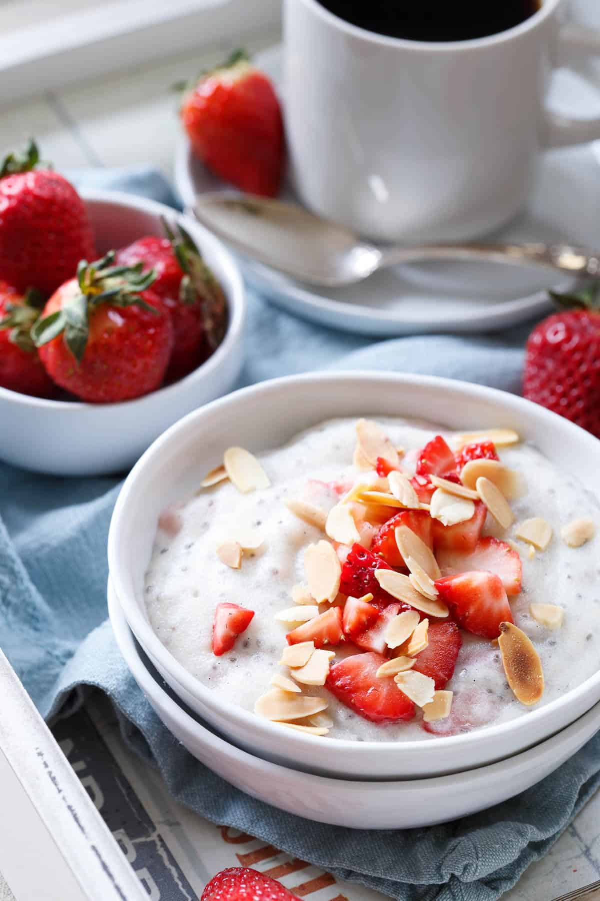 These protein packed polenta breakfast bowls are made with creamy coconut milk and filled with juicy ripe spring strawberries for a sweet start to the day.