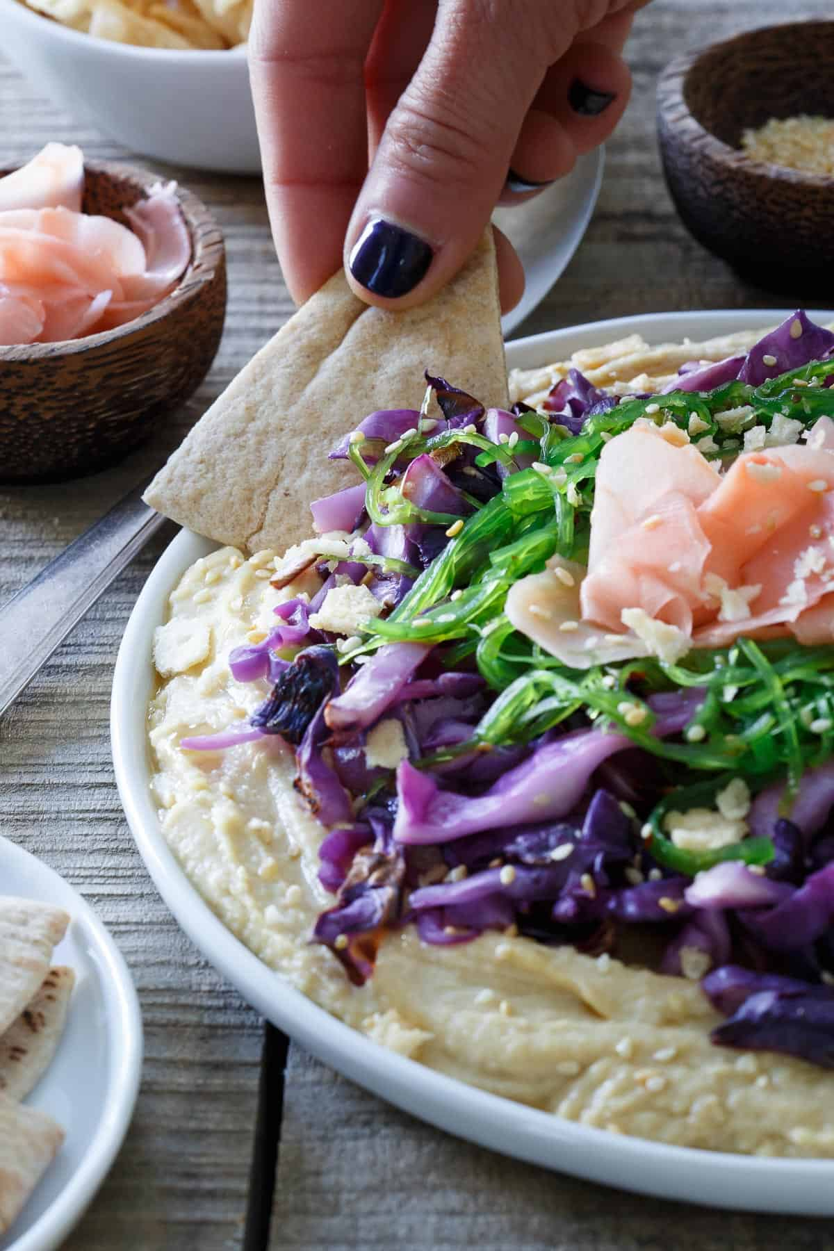This Asian topped hummus platter is one delicious way to amp up your appetizer game!
