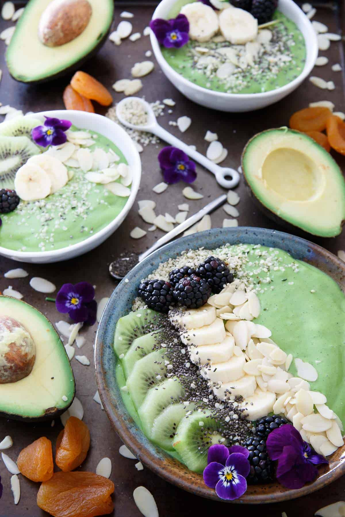 This avocado pineapple smoothie bowl is packed full of superfoods for a healthy start to the day. The topping choices are endless!