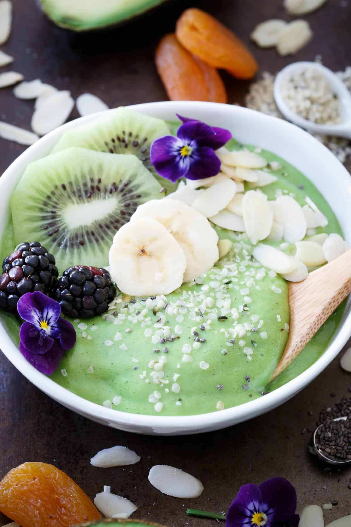 Avocado pineapple smoothie bowls are packed with superfoods and perfect for breakfast!