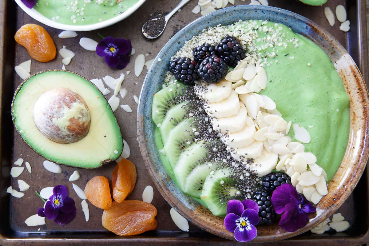 Why drink your smoothie when you can have this Avocado pineapple one in a bowl with endless toppings!