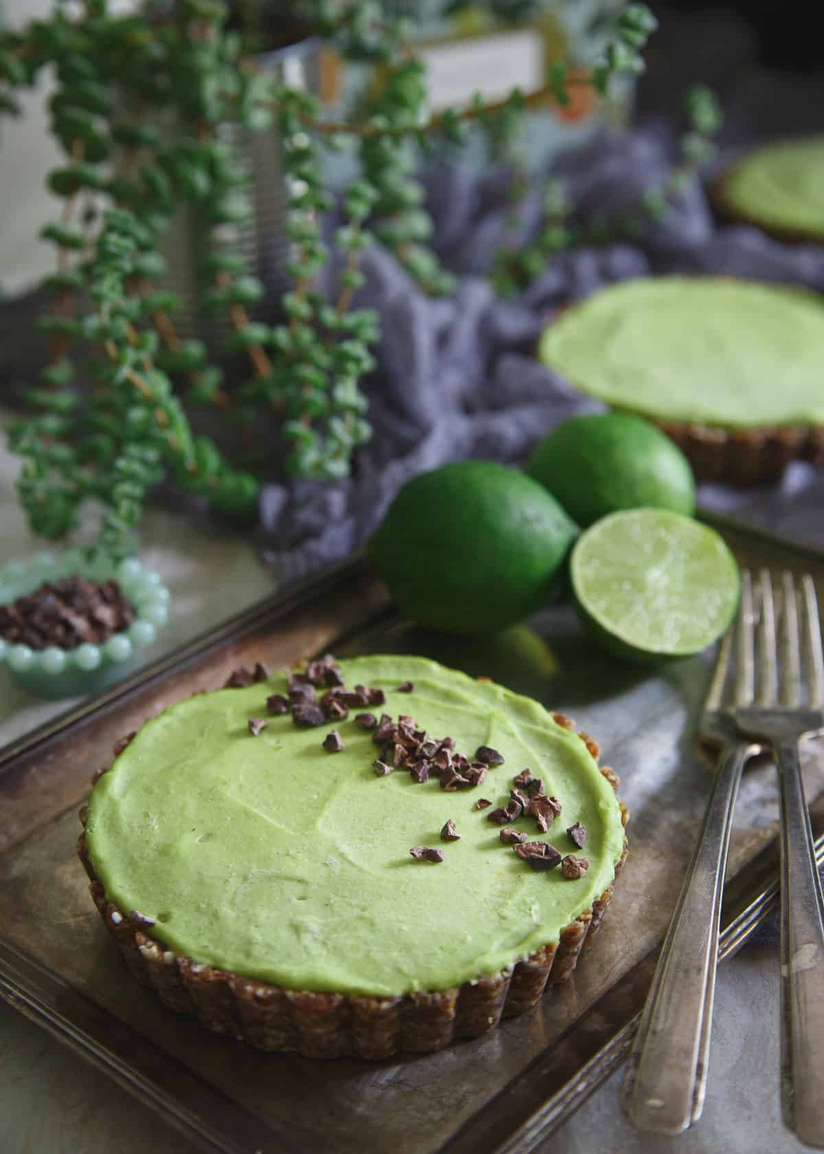 This avocado tart full of zesty lime flavor, no bake, paleo, grain free and gluten free makes the perfect refreshing summer treat!