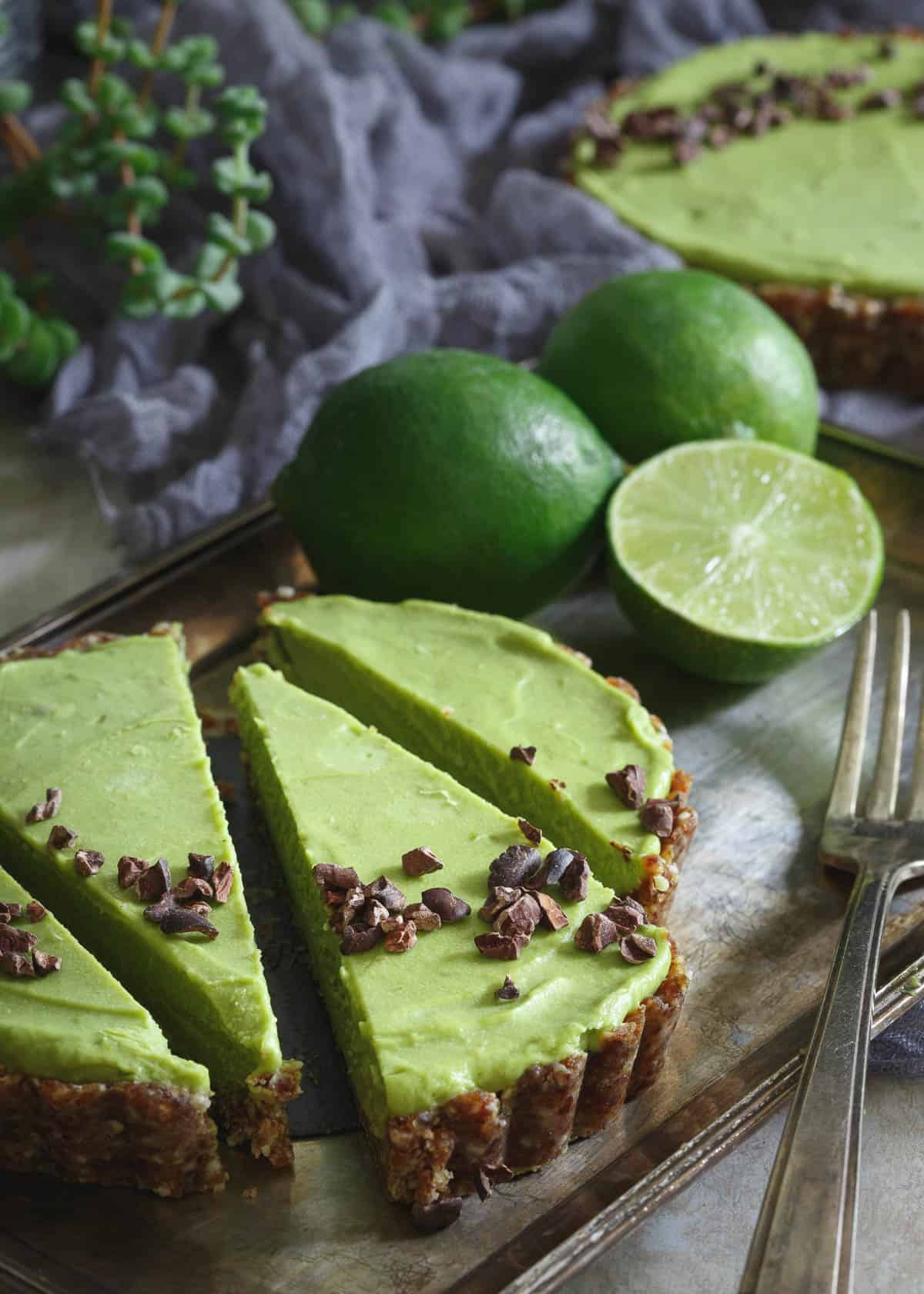 This No Bake Lime Avocado Tart is grain free, gluten free and paleo. A healthy and delicious summer treat!