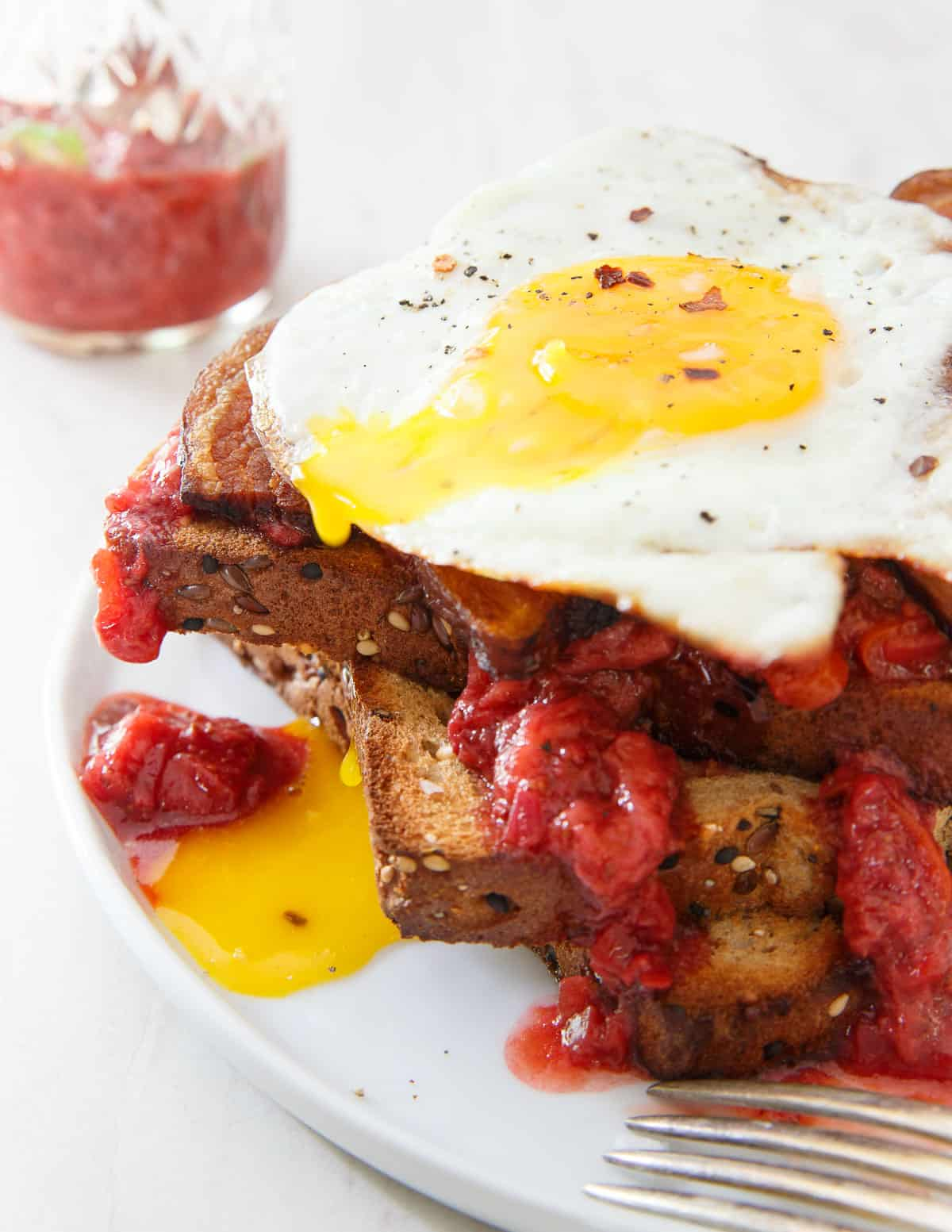 Strawberry Chili Jam makes the ultimate breakfast sandwich with some crispy bacon and a runny egg