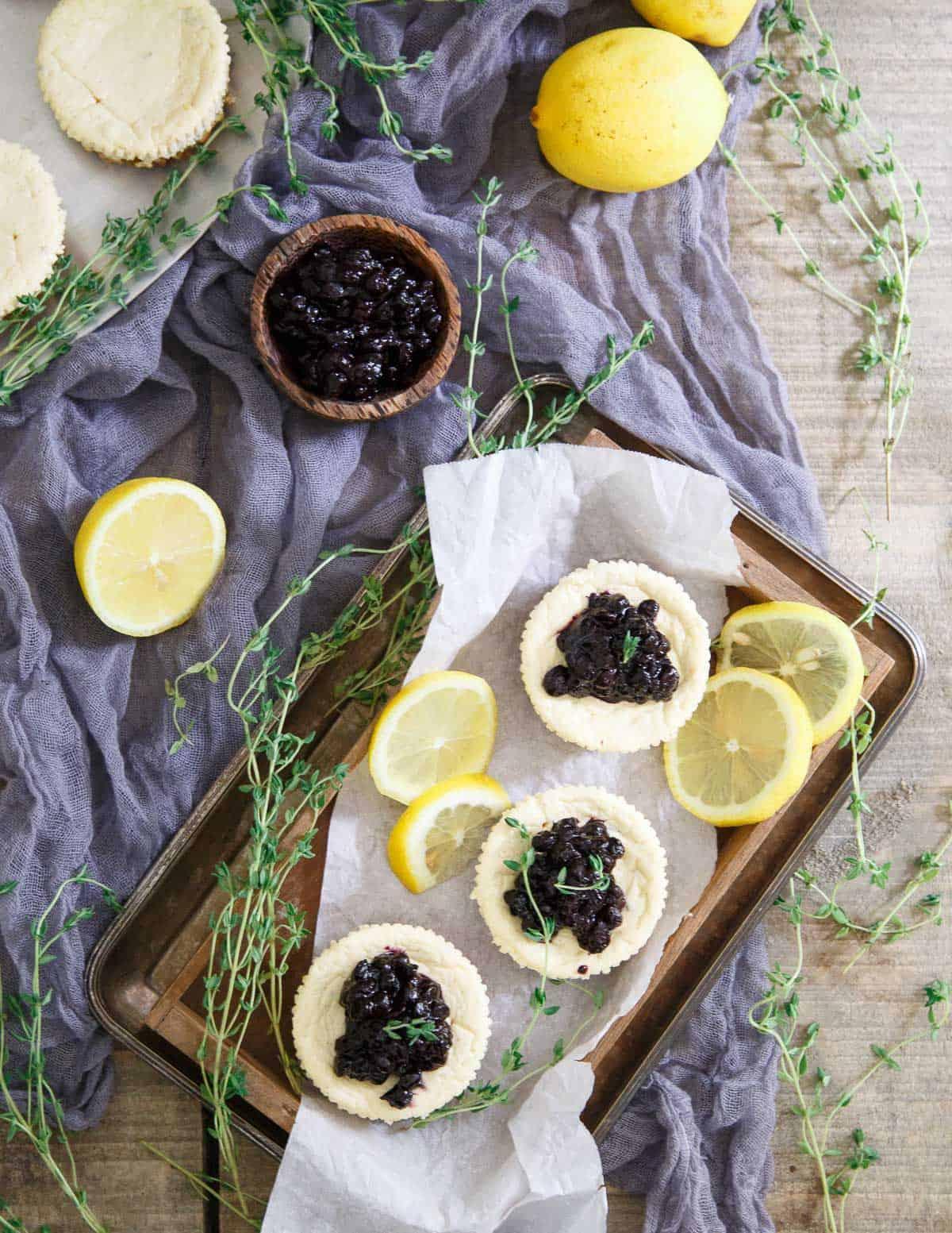 Lemon Thyme Blueberry Mini Cheesecakes are a delicious gluten free sweet bite