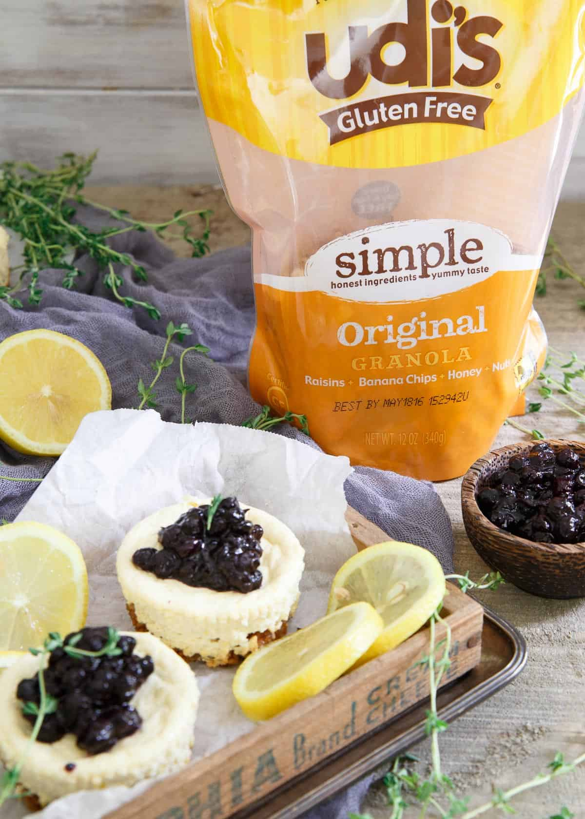 These gluten free Lemon Thyme Mini Cheesecakes have a crunchy granola crust and a quick blueberry compote topping.