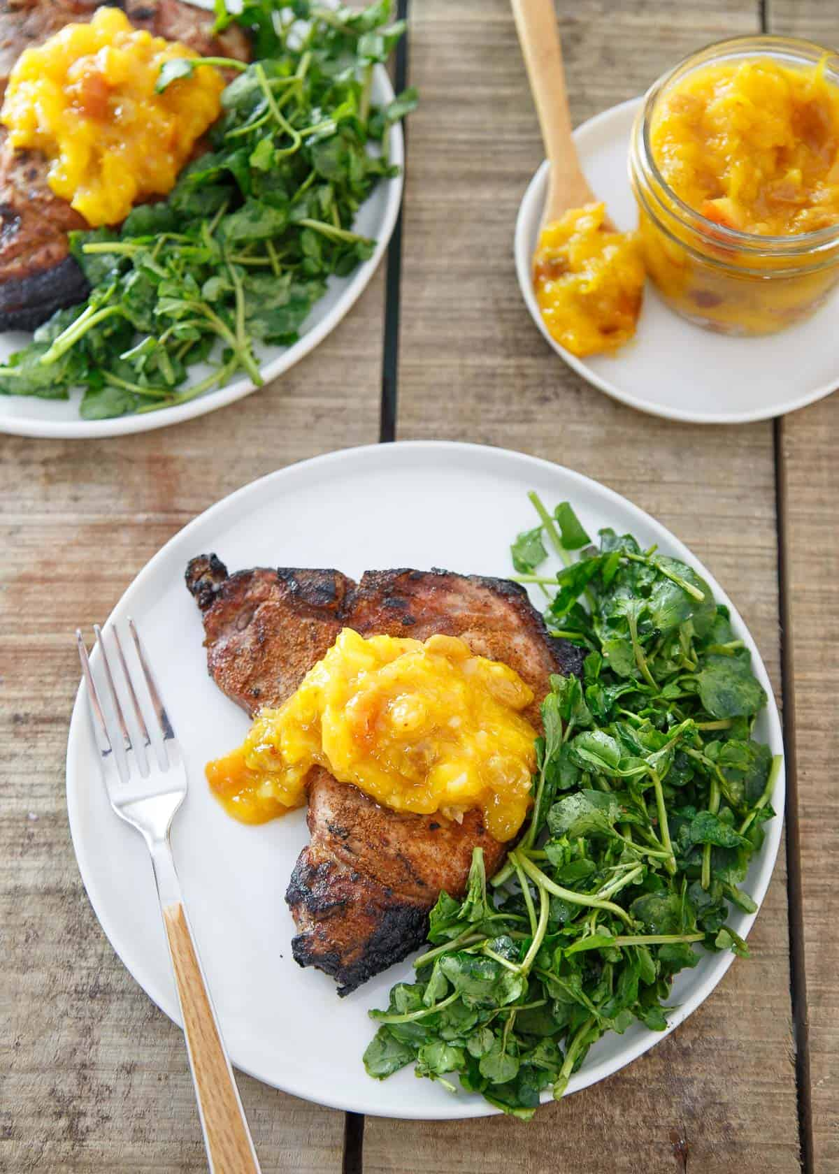 Thick cut bone-in pork chops are spice rubbed, grilled and topped with a mango peach chutney that brings the perfect sweetness to each bite.