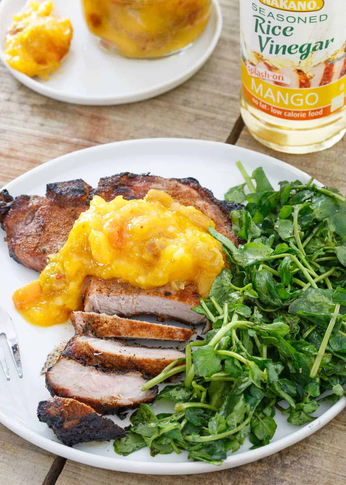 These grilled Spice Rubbed Pork Chops pair perfectly with the sweet mango peach chutney.