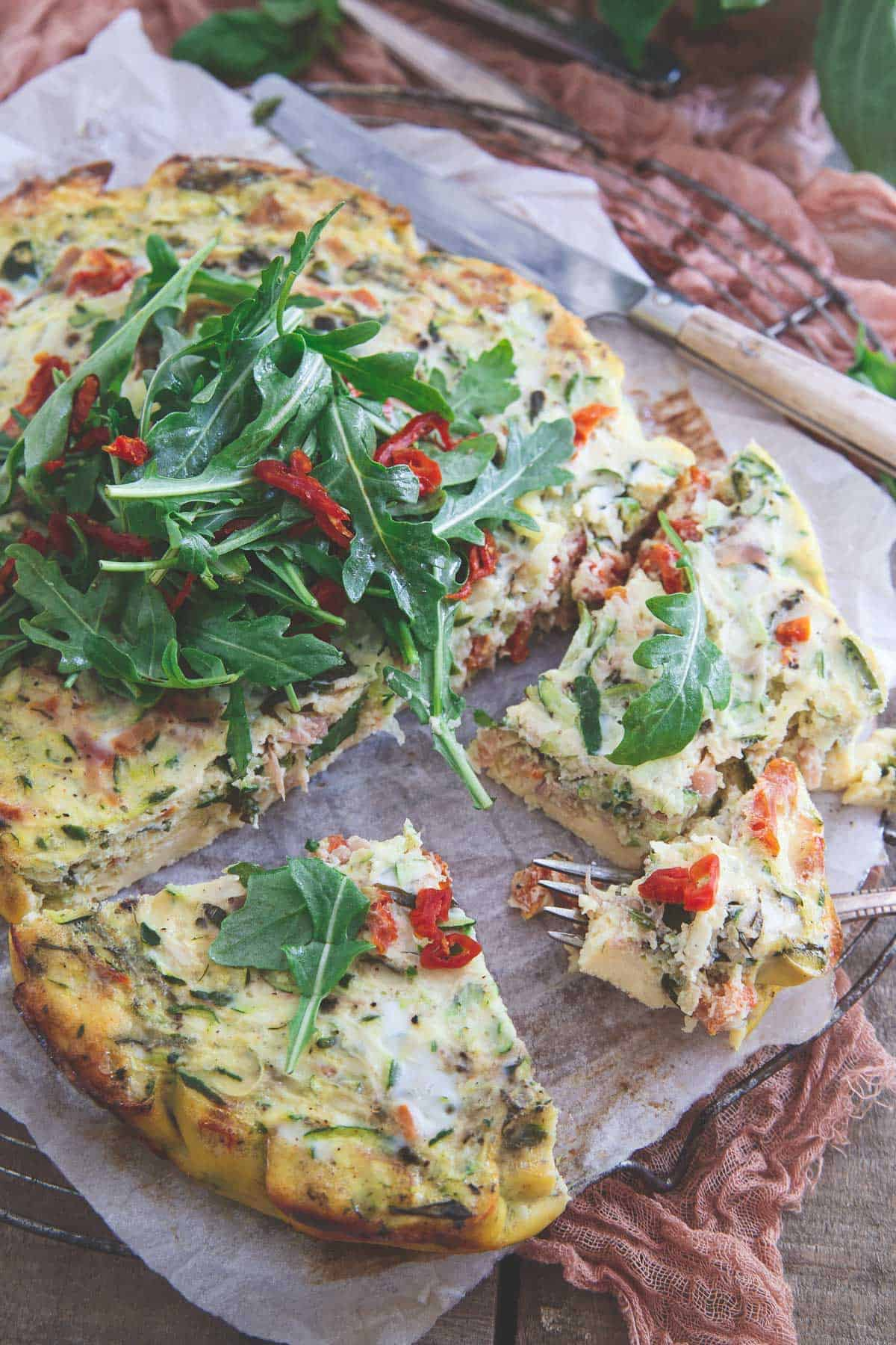 Keep the oven off with this Summer Slow Cooker Frittata bursting with zucchini, tomatoes, basil and prosciutto.