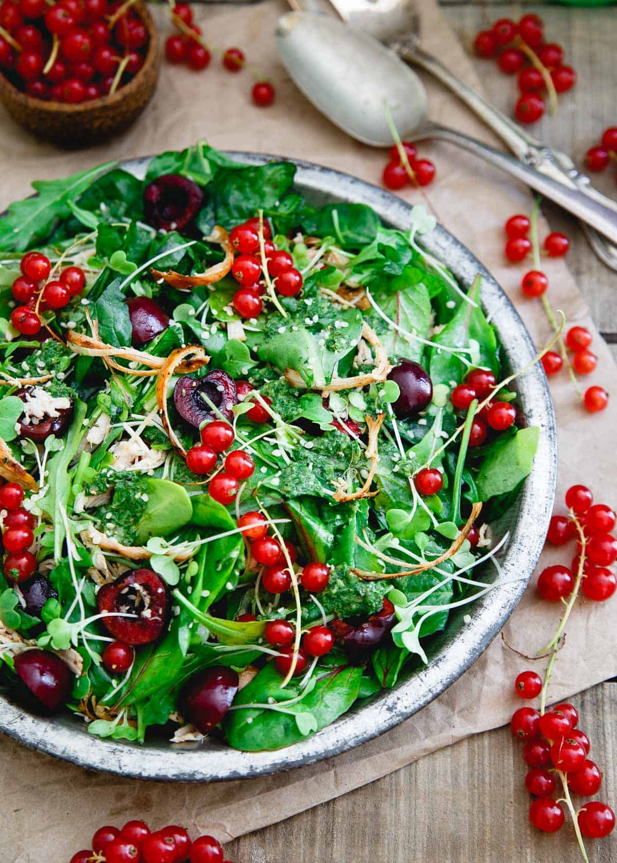 This Baby Kale Chicken Cherry Salad is bursting with summer flavor and tossed in a basil dijon dressing.