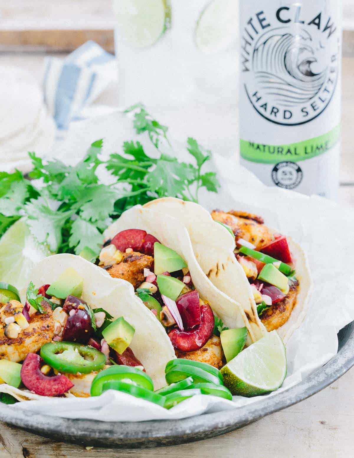 Blackened Shrimp Tacos with Grilled Corn Cherry Salsa is a simple summer meal packed with flavor.