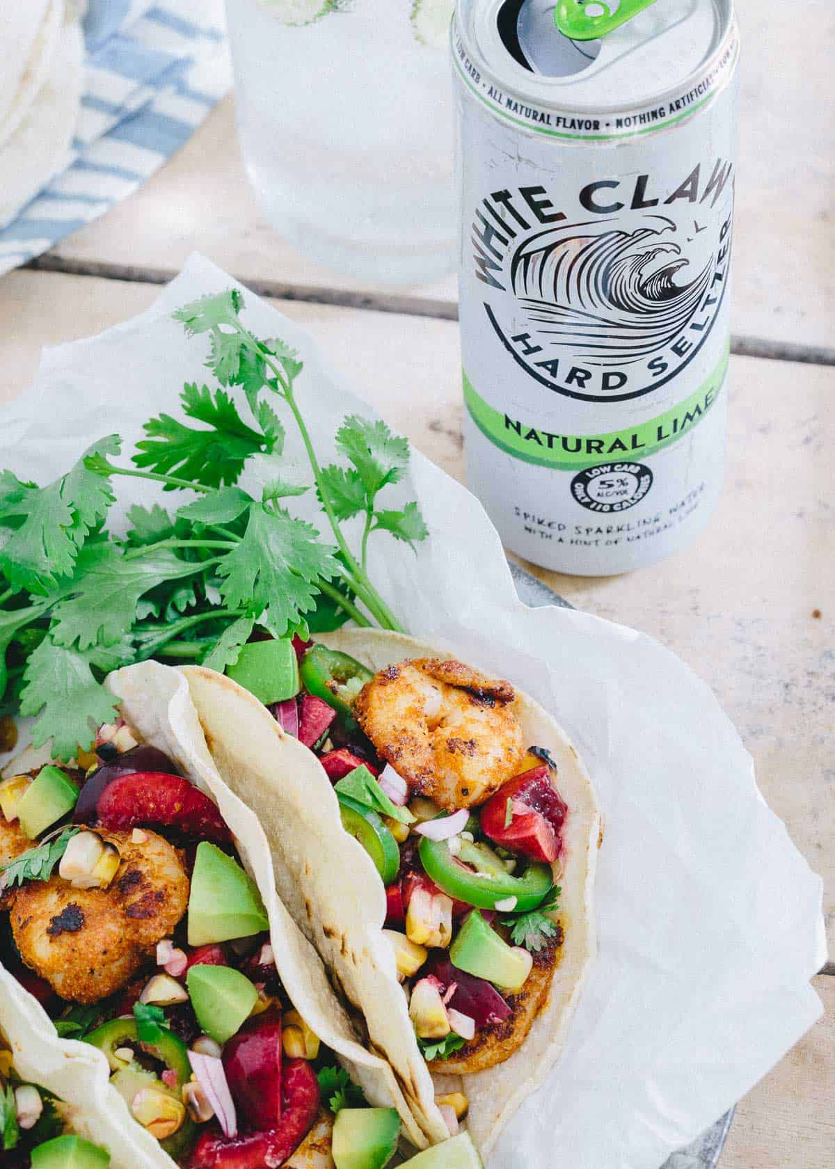 Make these Blackened Shrimp Tacos with Grilled Corn Cherry Salsa for a light summer meal.
