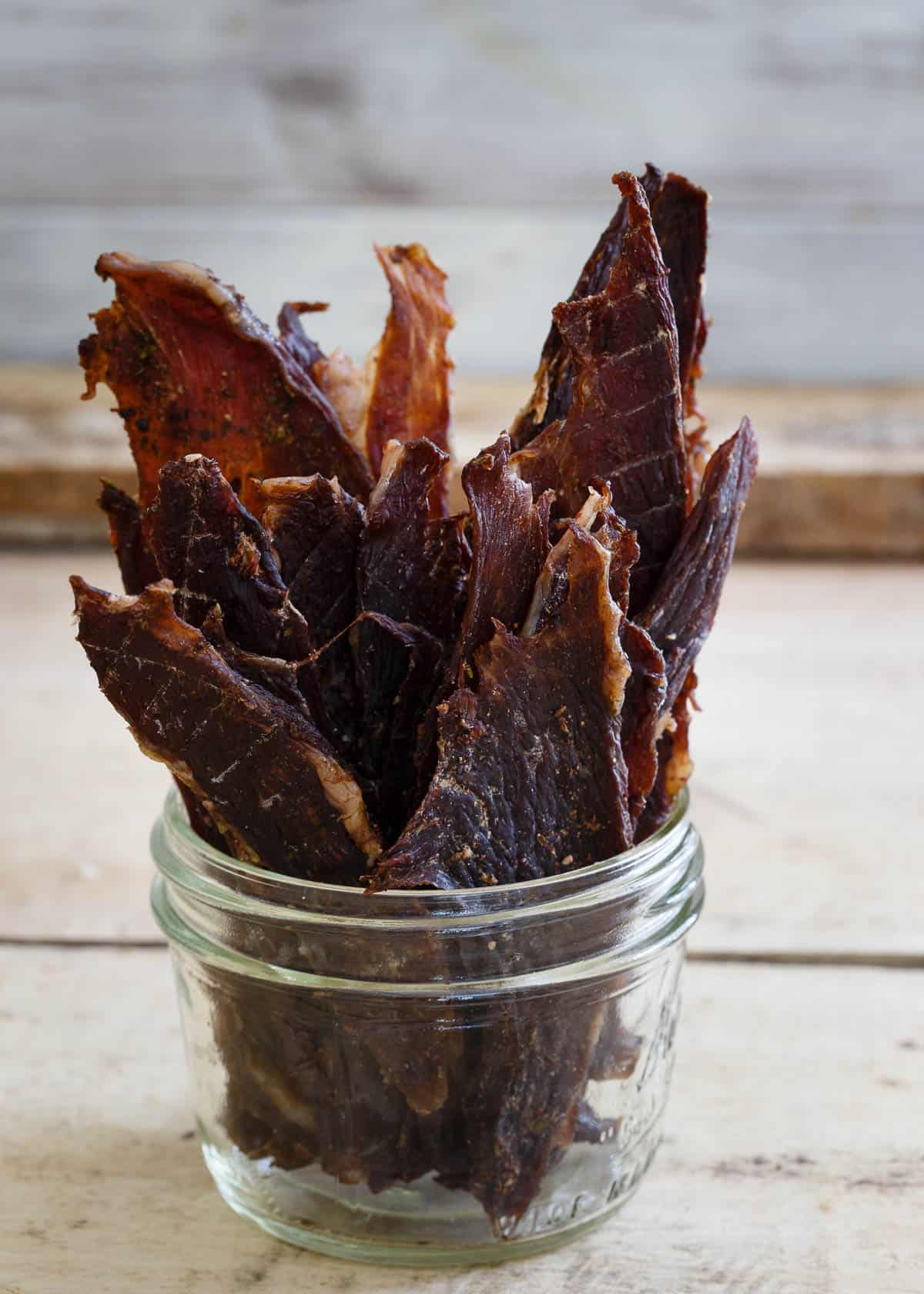 This lamb jerky is seasoned with oregano, soy sauce, worcestershire, garlic and onion, a great alternative to beef and perfect for healthy snacking.