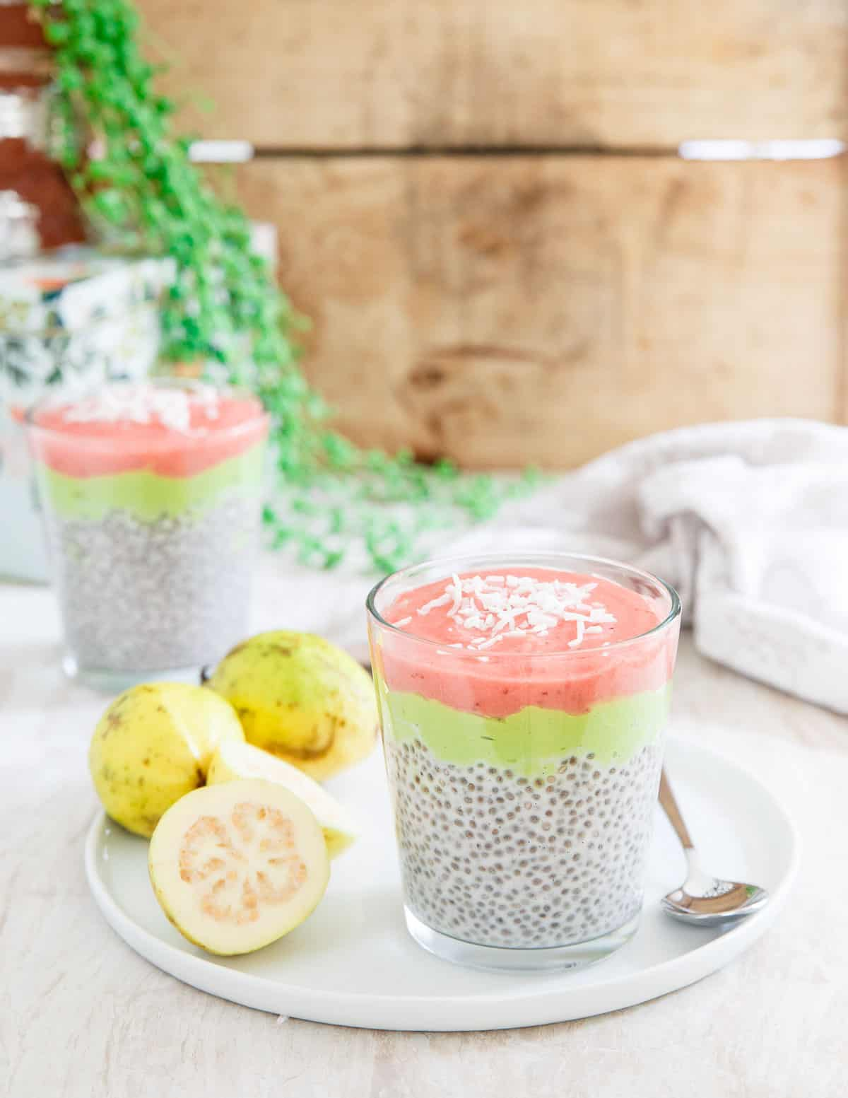 This guava chia pudding has a vanilla chia base, a creamy avocado banana middle layer and a sweet and tangy strawberry guava jam topping.