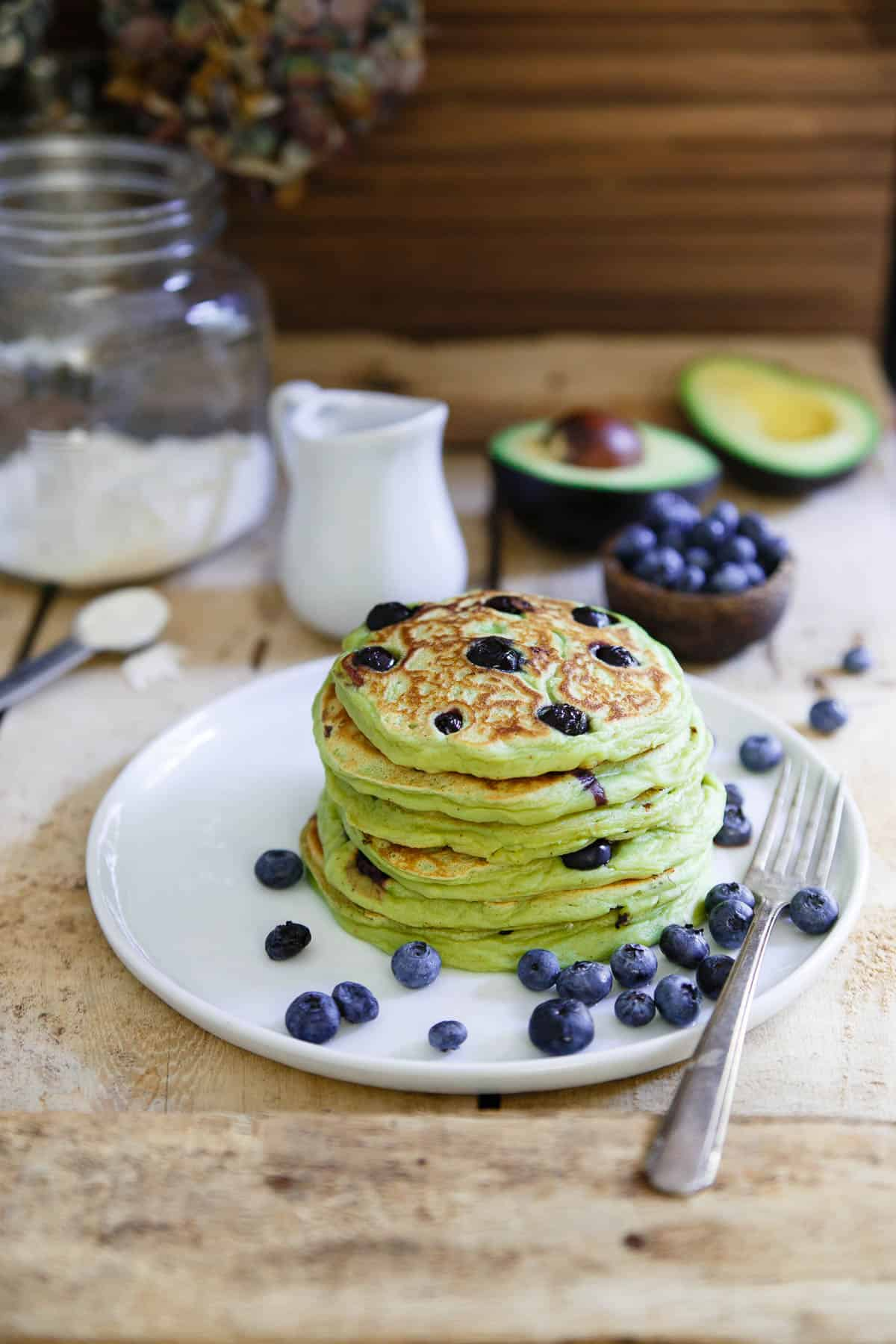 These avocado pancakes are packed with fresh blueberries, fluffy, thick and when topped with a poached egg, the perfect combination of savory and sweet.