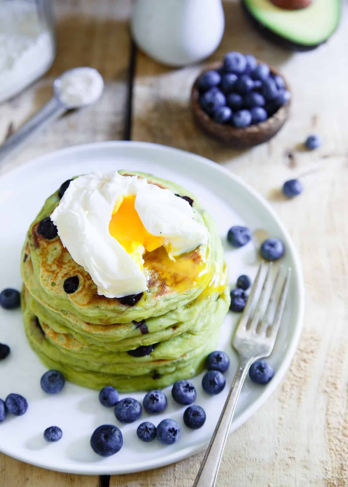Blueberry Avocado Pancakes are thick, decadent and perfect with a poached egg on top.