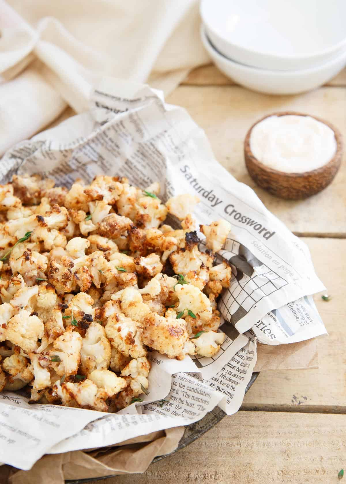 If you love popcorn shrimp, you'll love this salt and vinegar popcorn cauliflower. Just as addictive but a lot healthier.