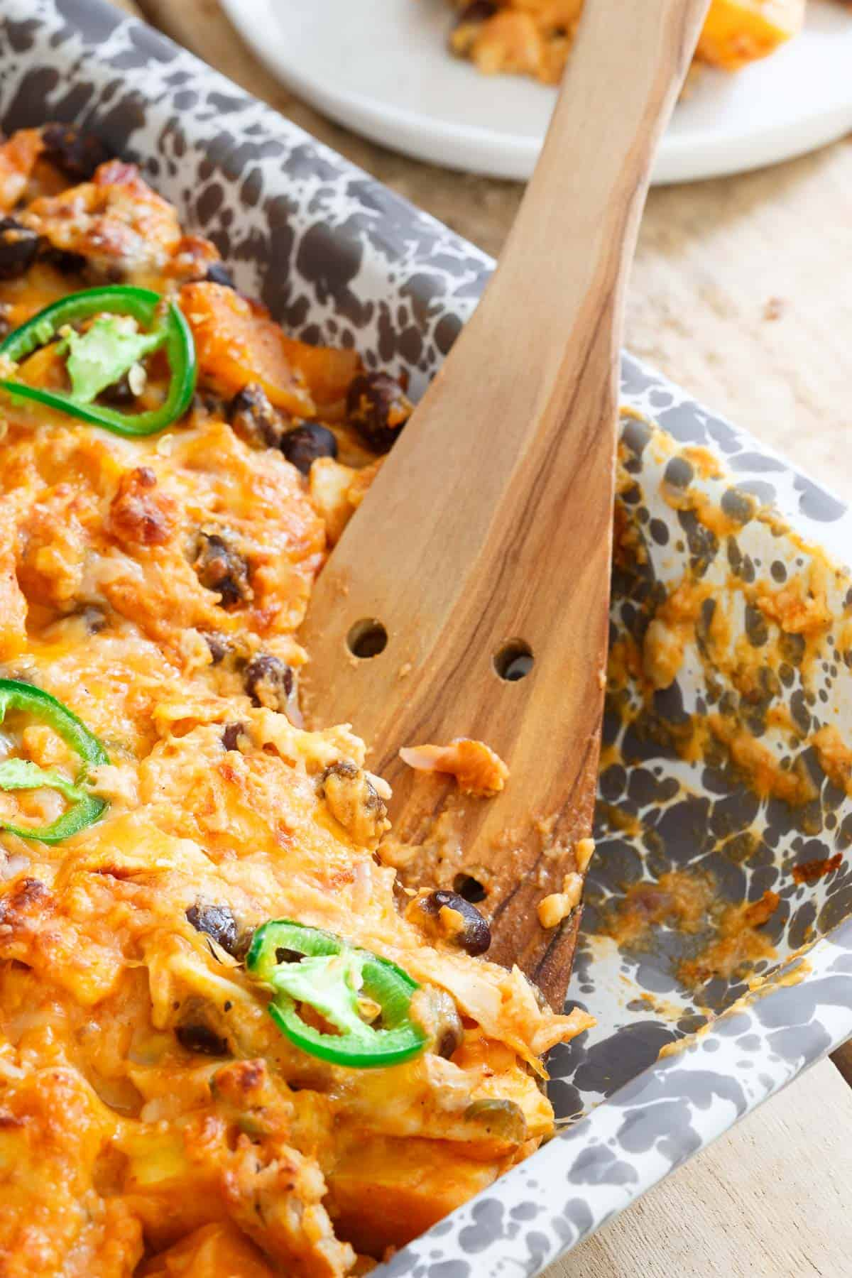 Creamy, cheesy and packed with superfood nutrition, get this gluten free pumpkin tortilla casserole on the table this week!