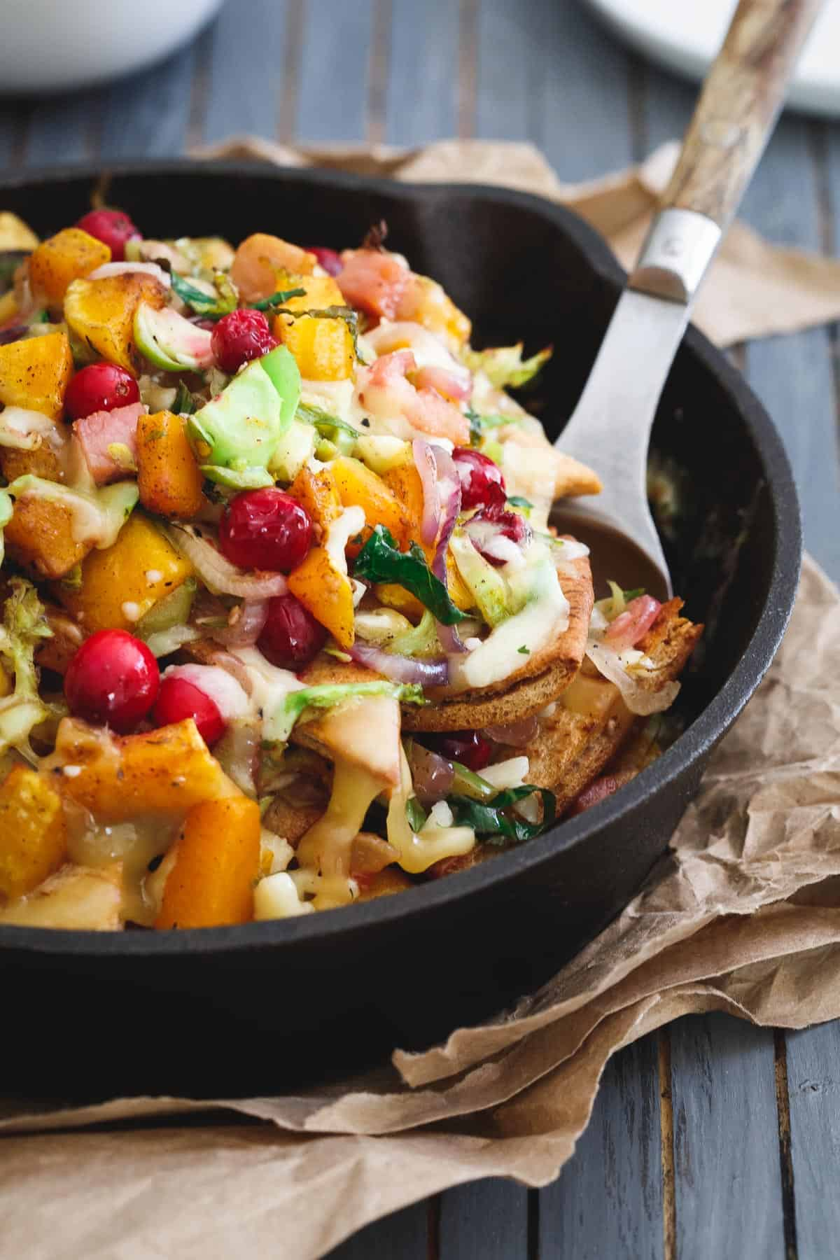 Butternut squash pita nachos packed with tons of fall flavor and melted cheddar and gouda.