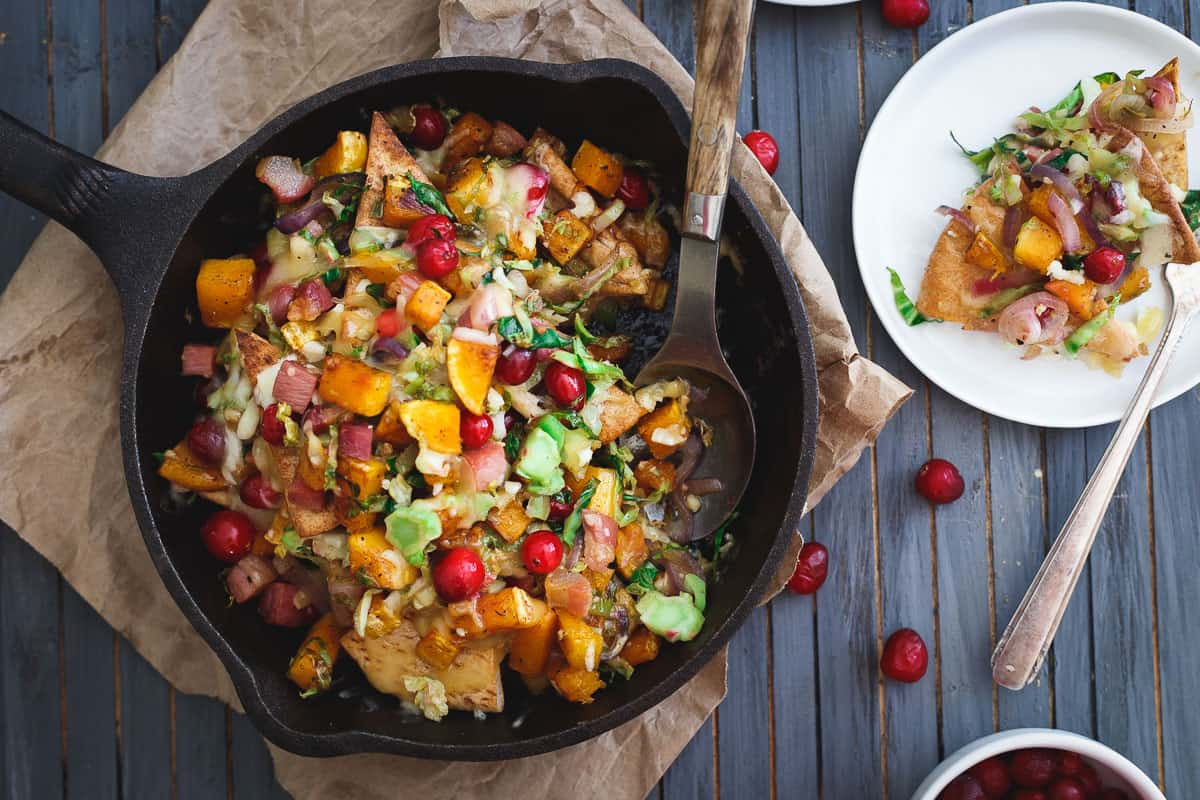 Butternut squash pita nachos with cranberries, pancetta, brussels sprouts and caramelized red onions.