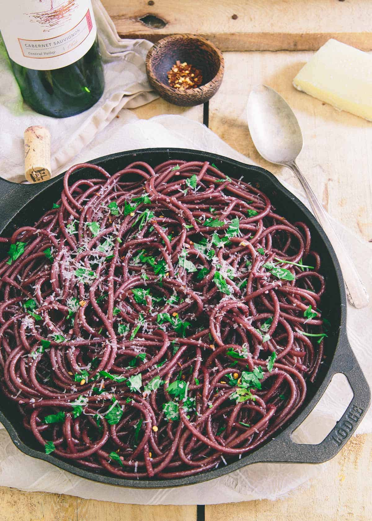 This red wine garlic bucatini is cooked in wine and then sautéed in a red wine garlic sauce. Top it with a soft boiled egg for a stunningly simple dinner.
