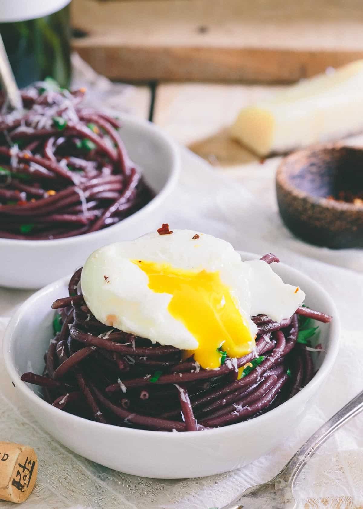 Top this red wine garlic bucatini with a soft boiled egg for a simple yet elegant dinner.