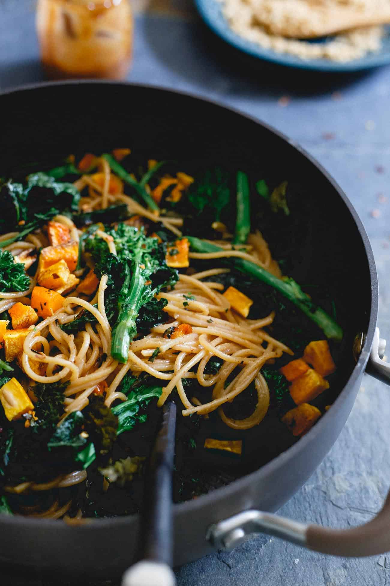 A creamy almond butter sauce is tossed into this fall pasta for an Asian flair with all the coziness of a fall recipe.