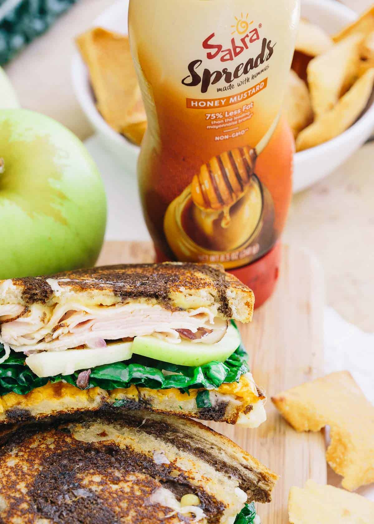 This roasted sweet potato apple ham sandwich has a tangy sweet honey mustard spread, melted cheddar cheese and caramelized red onions all piled high for one delicious bite!