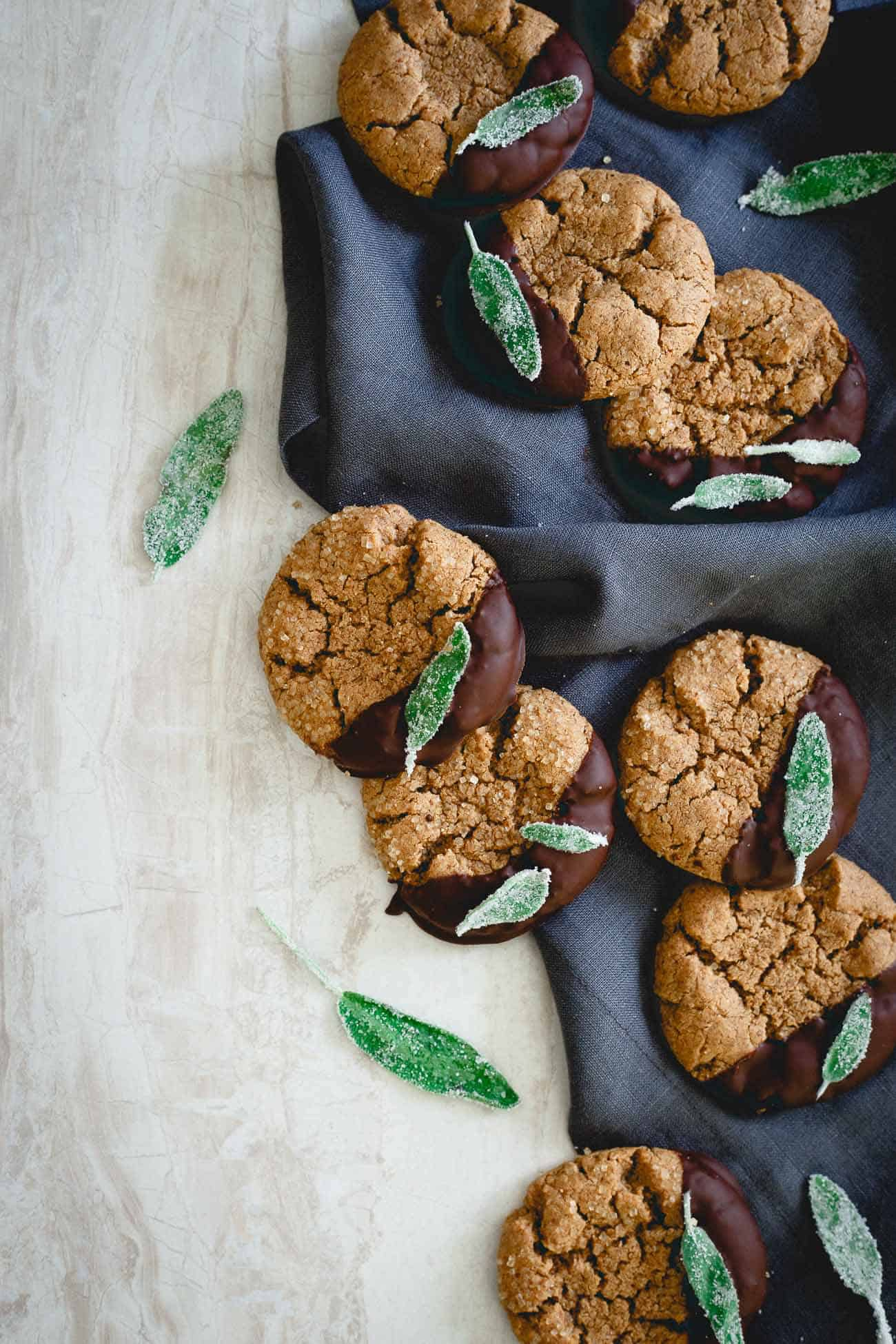 Add these chocolate dipped cashew almond butter cookies with candied sage to your holiday cookie plans!