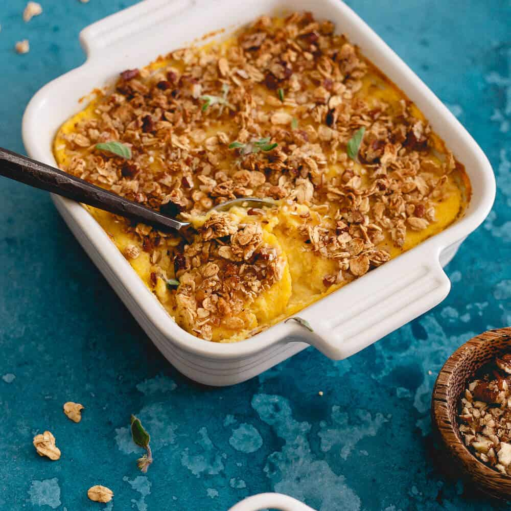 This cauliflower pumpkin mash is made with creamy mascarpone and topped with vanilla granola and pecans. A healthier alternative to sweet potato casserole!