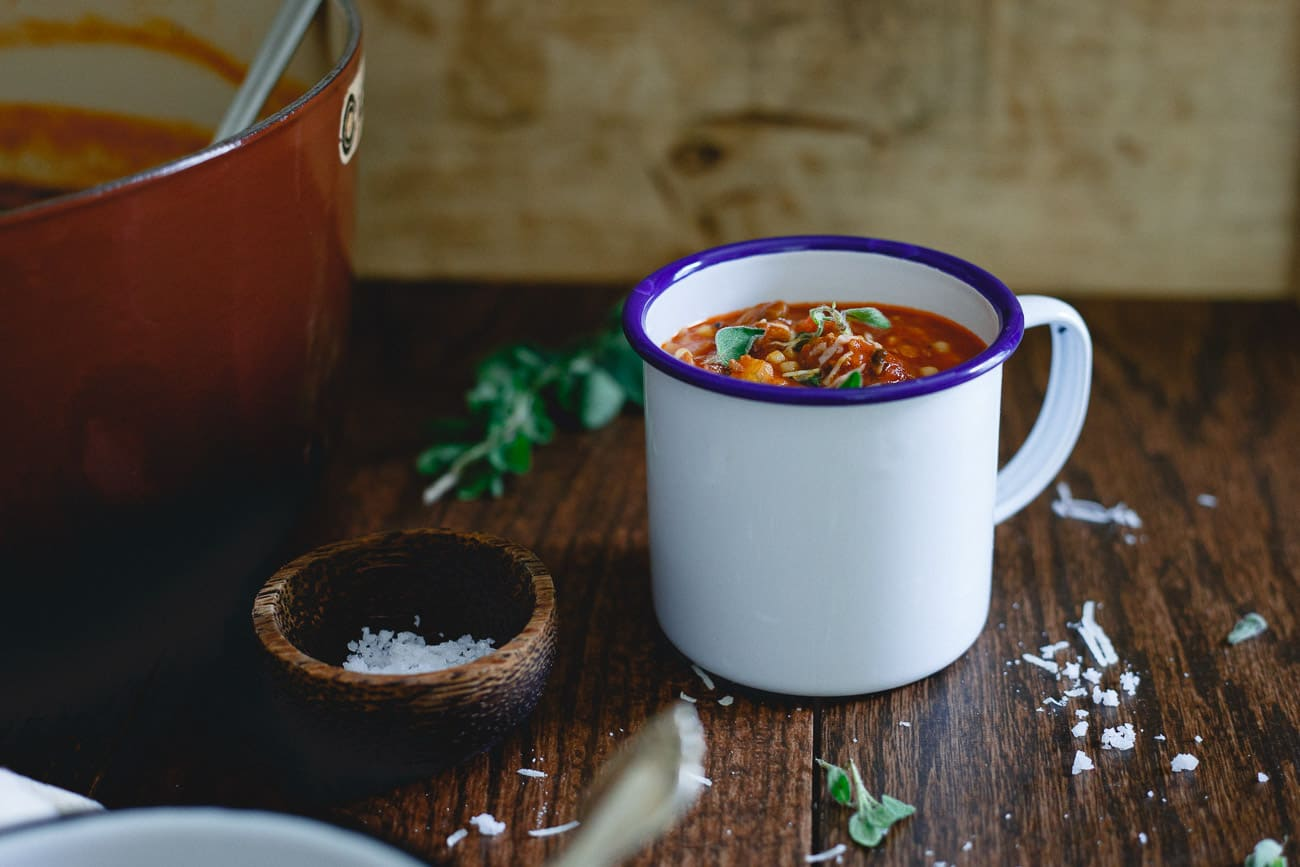 Tomato Pasta Soup is filled with beef, sausage, acini de pepe pasta, mushrooms and escarole for a hearty cozy meal.