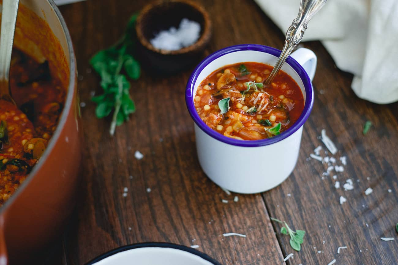 Filled with beef, sausage, mushrooms and escarole, this Italian Tomato Pasta Soup recipe is an outrageously comforting meal.