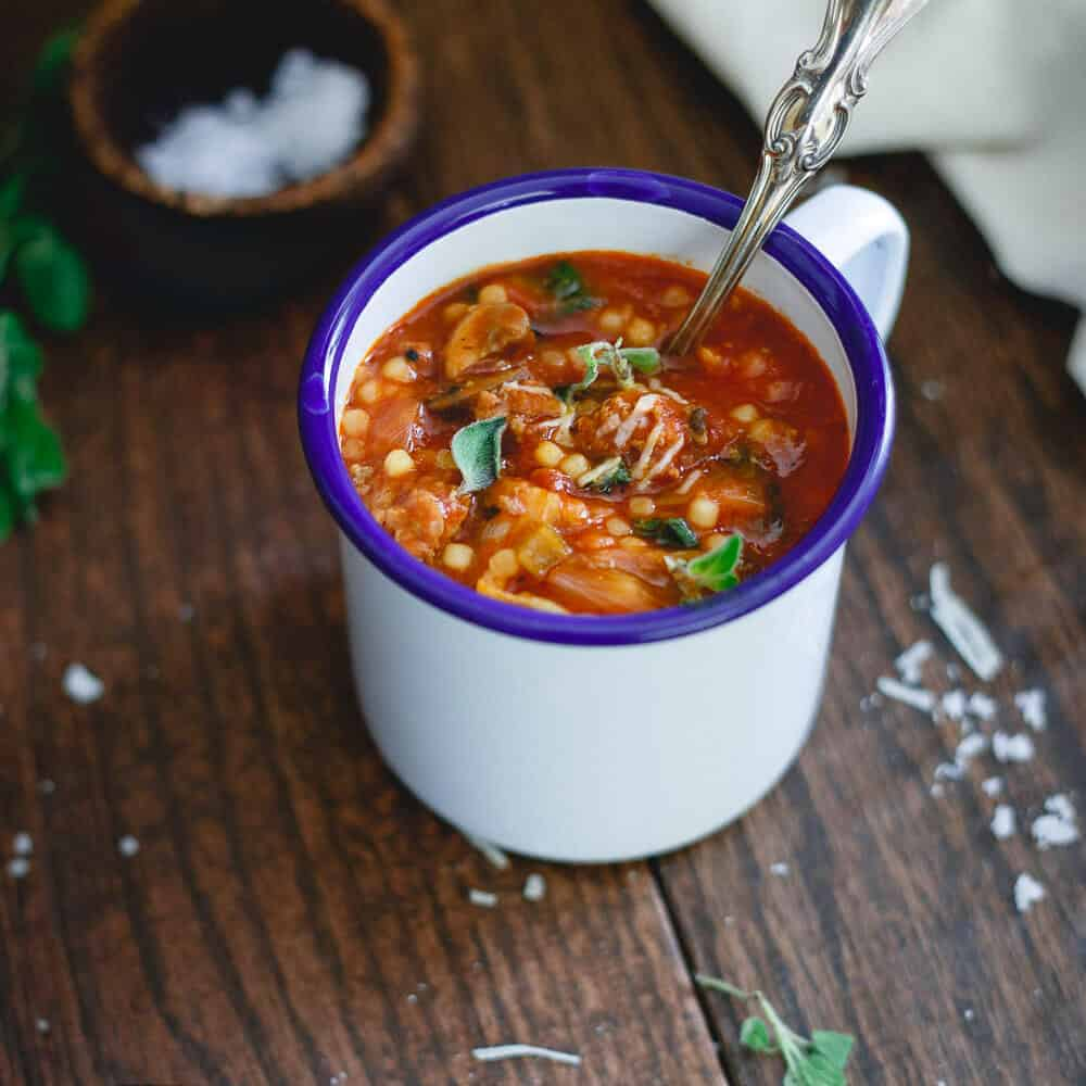 Italian tomato pasta soup is filled with hearty ground beef, sausage, mushrooms and escarole. It's the perfect bowl of comfort for the colder months ahead.