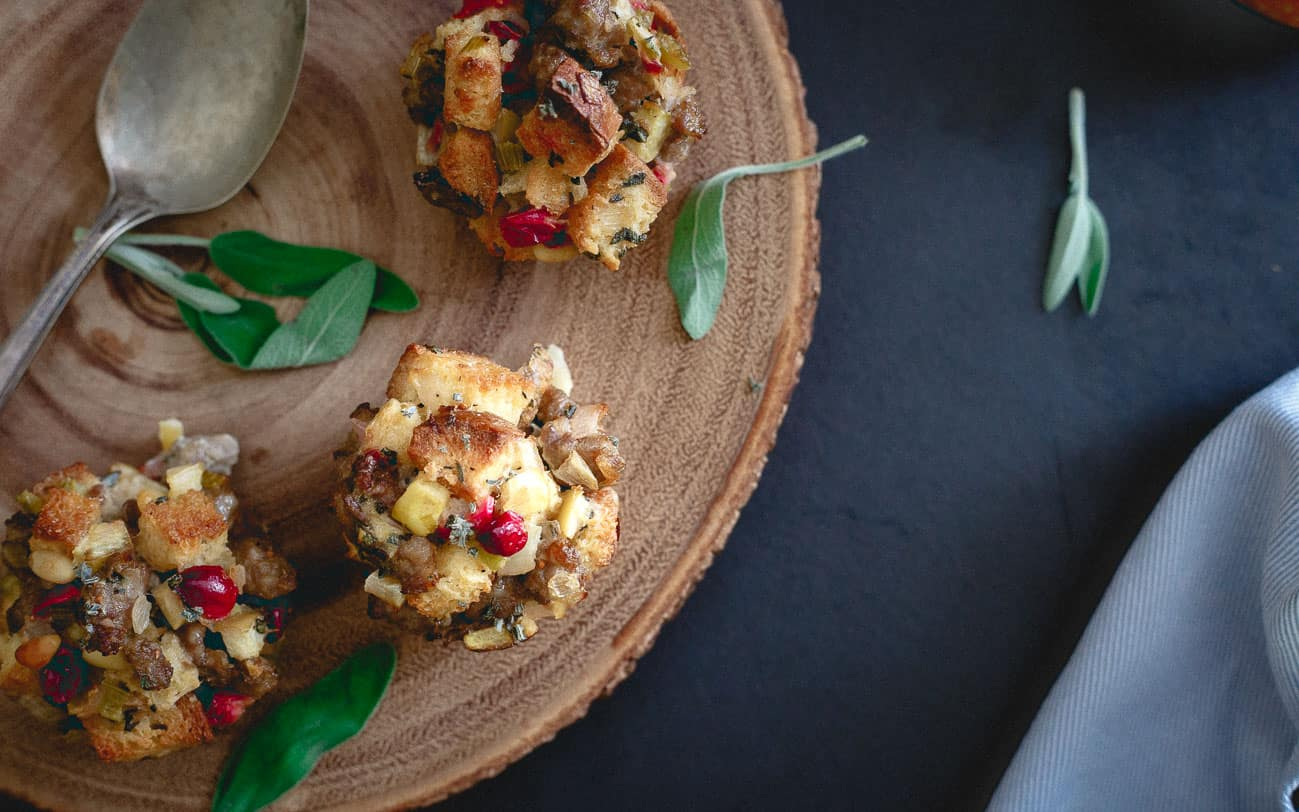 Stuffing muffins filled with sausage, cranberries and apples are a fun twist to traditional stuffing.