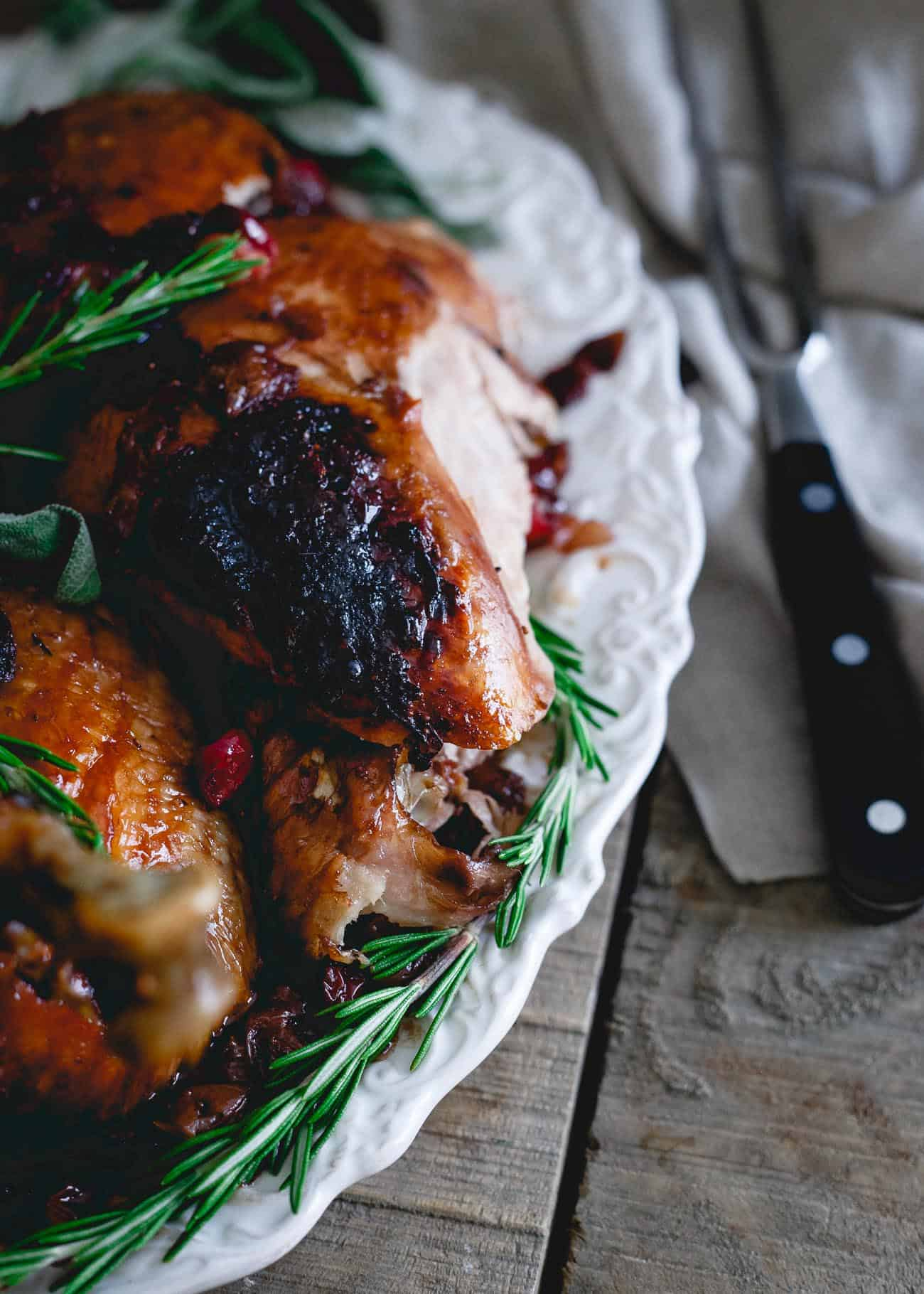 Basting this organic heirloom turkey in a cherry cranberry glaze makes for the most deliciously moist and flavorful turkey you'll have this holiday season!